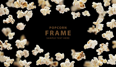 Popcorn frame, flying popcorn isolated on black background with copy space, movie poster concept