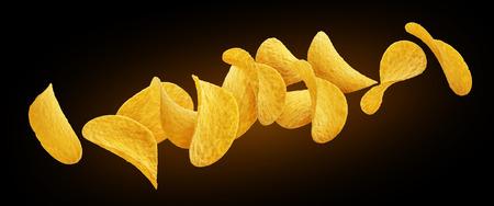 Falling potato chips isolated on black background Stock Photo