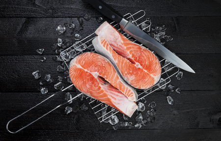 Fresh salmon steak on black background, top view Stock Photo