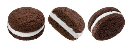 Chocolate sandwich cookies, baked biscuits stuffed with milk cream isolated on white background