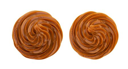 Swirl of caramel cream isolated on white background, top view Imagens