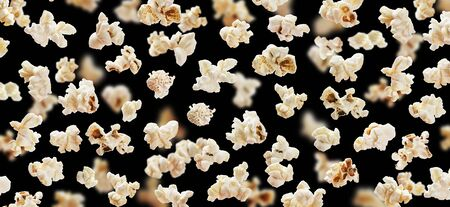 Flying popcorn isolated on black background, movie poster concept