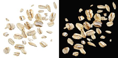 Oat flakes isolated on white and black background with clipping path, falling oats collection, top view 免版税图像