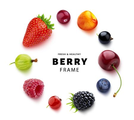 Round frame made of different forest berries, with copy space, flat lay, top view, fresh strawberry and blueberry, ripe cherry, raspberry, gooseberry and blackberry, black and red currants