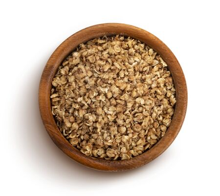 Buckwheat flakes isolated on white background with clipping path