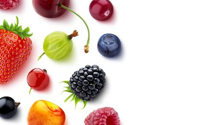 Assortment of different berries isolated on white background with copy space, flat lay, top view, fresh strawberry and blueberry, ripe cherry, raspberry, gooseberry, blackberry and currants Reklamní fotografie