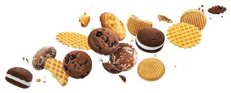 Falling cakes, cookies, crackers, waffles isolated on white background