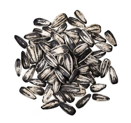 Pile of striped sunflower seeds isolated on white background with clipping path, top view Reklamní fotografie