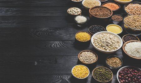 Various cereals, grains, seeds and beans, high fiber diet concept, photo filtered in vintage style Reklamní fotografie