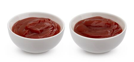 Ketchup in bowl isolated on white background