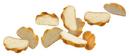 Falling slices of white bread isolated on white background