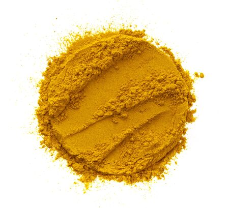 Turmeric powder, round pile of curcuma spice isolated on white background, top view