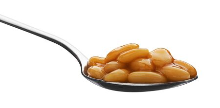 Metal spoon of baked beans in tomato sauce isolated on white background with clipping path