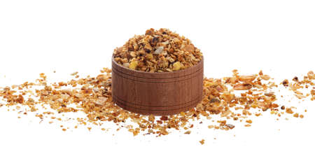 Crunchy granola in wooden bowl isolated on white background with clipping path Stock fotó