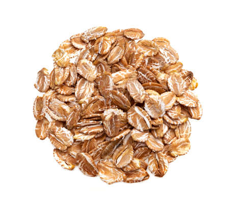 Pile of oat rye flakes isolated on white background with clipping path, oatmeal close up, top view