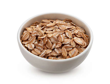 Oat rye flakes in bowl isolated on white background with clipping path