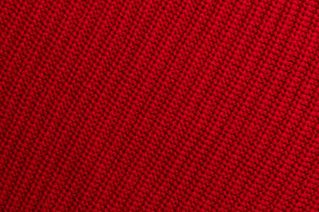 Red knitted woolen fabric background