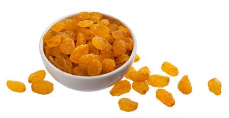 Bowl of golden raisins isolated on white background Фото со стока
