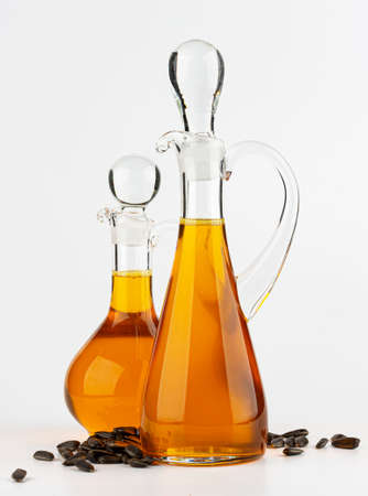 Decanter with sunflower oil isolated on white background 스톡 콘텐츠