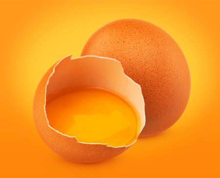 Fresh Chicken eggs isolated on yellow background Imagens