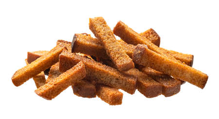 Pile of rye croutons isolated on white background Imagens