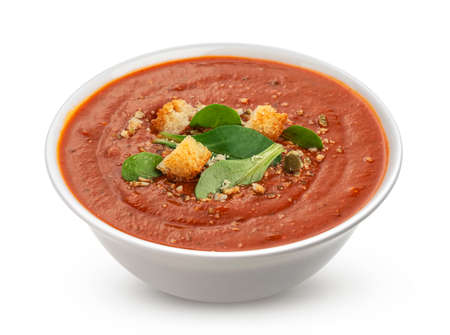 Bowl of tomato soup isolated on white background Imagens