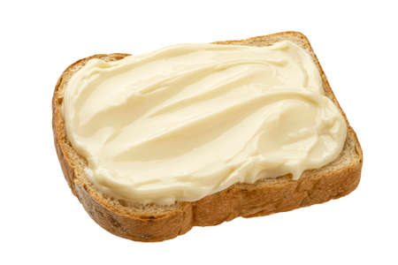 Slice of bread with cream cheese isolated on white background, top view Imagens