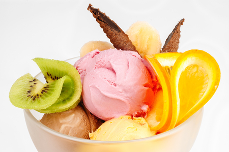 Ice cream dessert with fruits isolated on white
