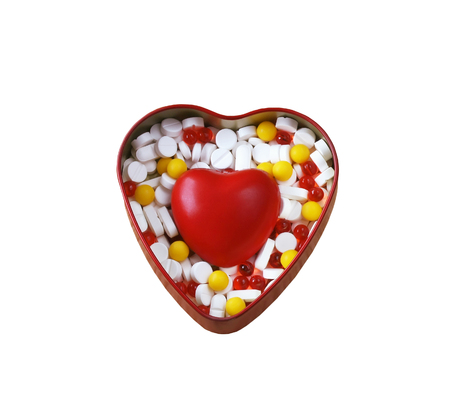 box of pills and red heart on white background, isolated Stock Photo
