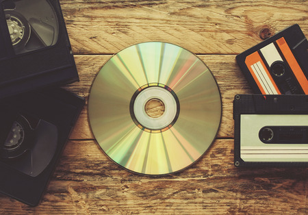 video tapes, audio tapes and compact disc on a wooden table Stock Photo - 73418284