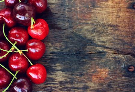 ripe sweet cherries on old table