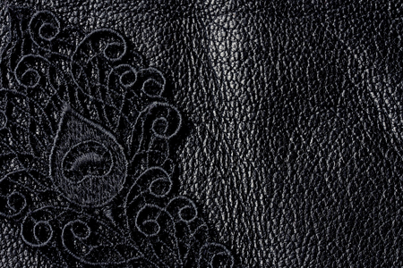 adult sex: Detail of black lace on leather, closeup background, space for text