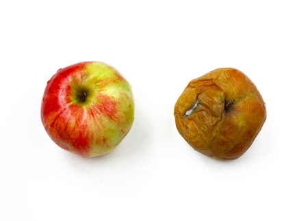 two apples, ripe and rotten, on white background, top view, closeup Stock Photo