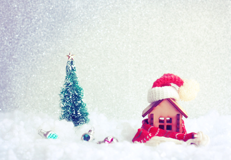 christmas, new year holiday greeting card, small house with scarf and hat in snow, fir tree, toys, retro style