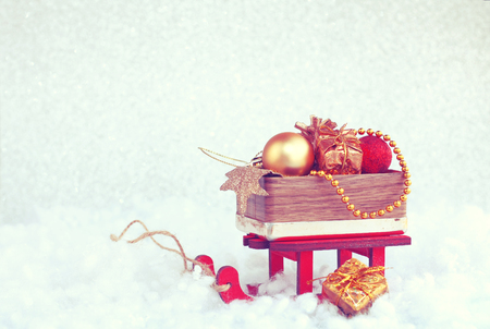 Christmas background, red sled with wooden box of baubles, vintage style