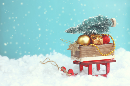 Christmas background, red sled with box Christmas toy, fir-tree, retro style