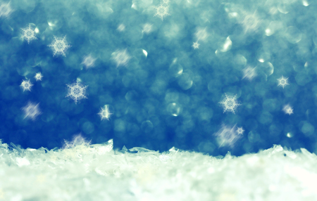 Christmas defocused holiday background, snow and snowflakes, space for text, selective focus