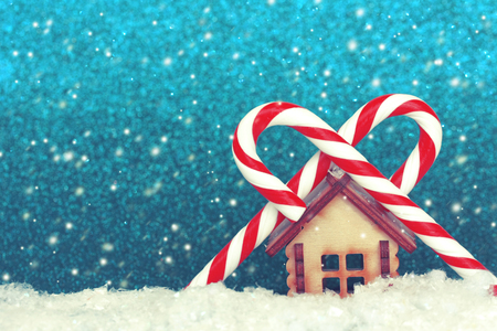 Christmas, New year background, toy house and two striped lollipops, retro style, selective focus Banco de Imagens