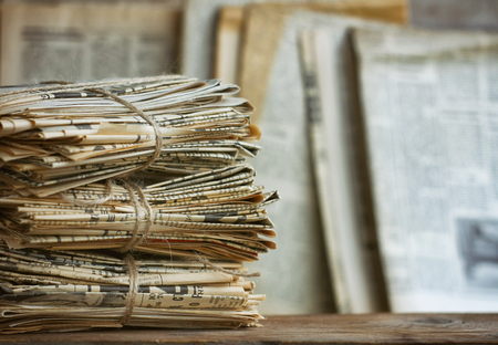 Waste paper pile in vintage style. Old newspaper abstract background. Paper trash waste paper.