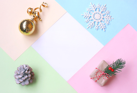 Christmas, New year background, pastel color paper, gift box, golden ball, pine cone and snowflake, free space for text