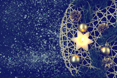 Christmas card with candle, fir tree branches, gold balls, on black background, snow, vintage style Stock Photo