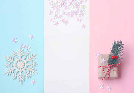 Christmas, New year background, pastel color paper, gift box and snowflake, confetti stars, free space for text