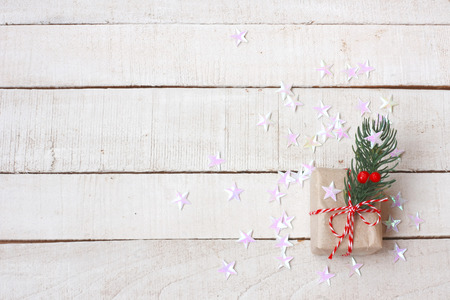 Vintage Christmas gift box, white stars confetti on wooden table, top view Stock Photo