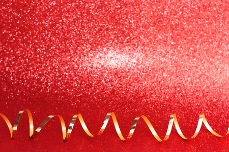 Christmas, New year decoration, red background, gold christmas ribbon. Valentines day