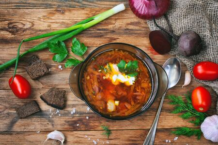 Borscht, healthy dinner, lunch.  Cooking food background. Healthy eating. Top view, wooden table.  Stock Photo