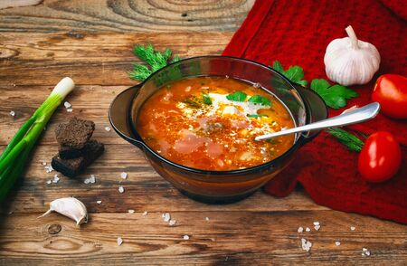 Borscht, healthy dinner, lunch.  Cooking food background. Healthy eating. Top view, wooden background.