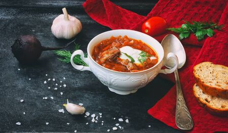 Borscht soup, healthy dinner, lunch.  Cooking food background. Healthy eating. Top view, black table. Stock Photo