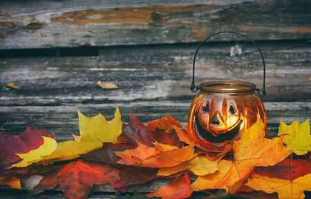 Vintage autumn halloween lamp candle on dark background. Autumn season. Home decoration. Halloween party. Dark background. Selective focus Stock Photo