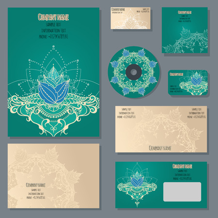 discs: Set of templates for cd discs, envelopes, notebooks, credit card, business card and invitation card with floral ornament. Corporate style with lotus flower.