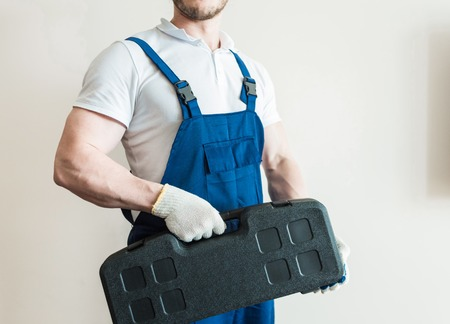male in overalls plumber, electrician, with tools, home repair, husband for an hour